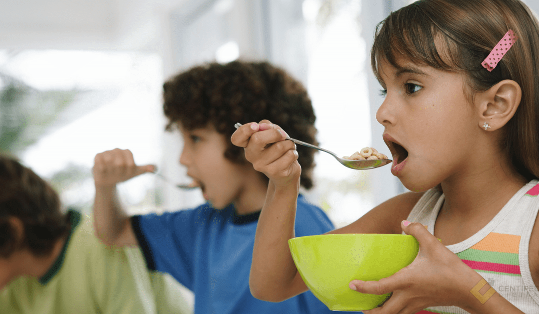 Kids eating cereal